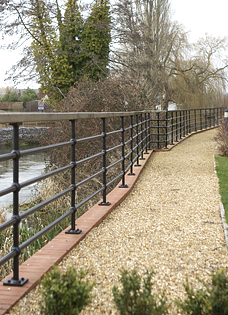 painted iron rails along riverside in Hampshire